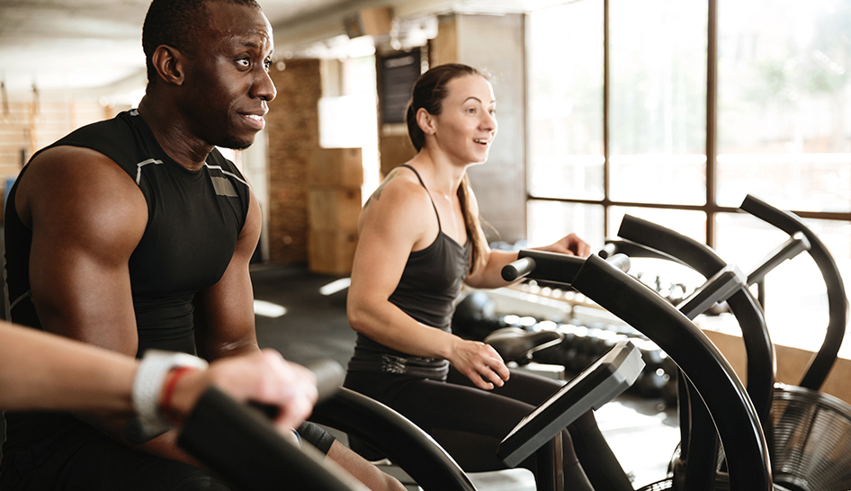 4 Reasons to Keep Going to the Gym During an Outbreak happy people equipment