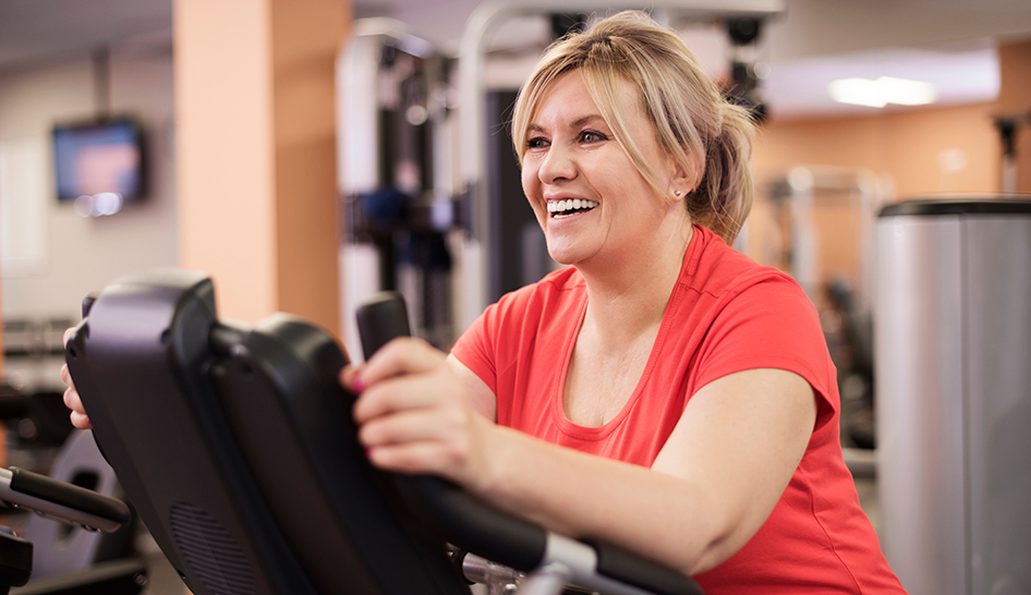 4 Reasons to Keep Going to the Gym During an Outbreak happy woman column width