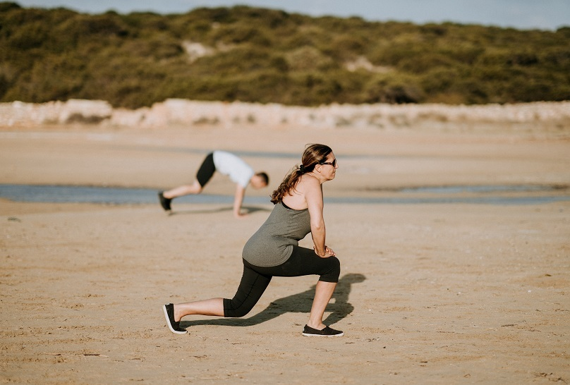 CBI Woman Exercising Beach Unsplash Column