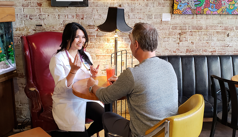 Health Professional Talking to Small Business Owner column image