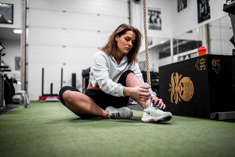 JWB report woman gym shoes unsplash column