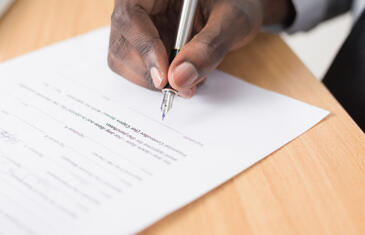Legal man signing document unsplash stock column