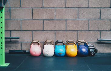 Strategy and finance row of kettlebells Unsplash stock column