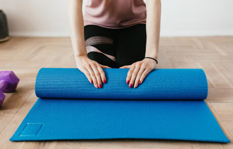 Facilities woman yoga mat clean Pexels Stock column