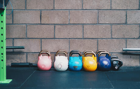 Strategy and finance row of kettlebells Unsplash stock column