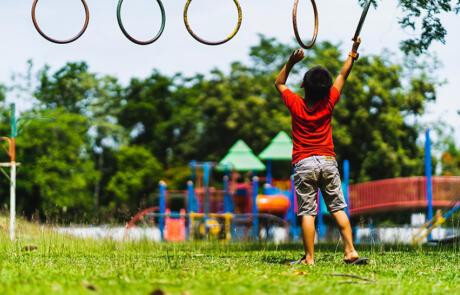 Wellness and community programming child playing playground unsplash stock column