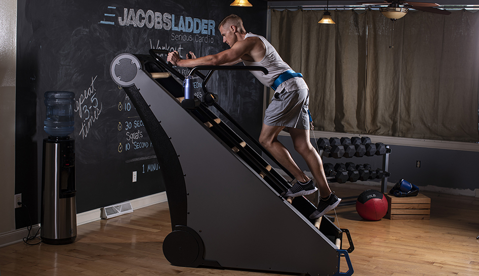 Fitness programming man using jacobs ladder limited use column