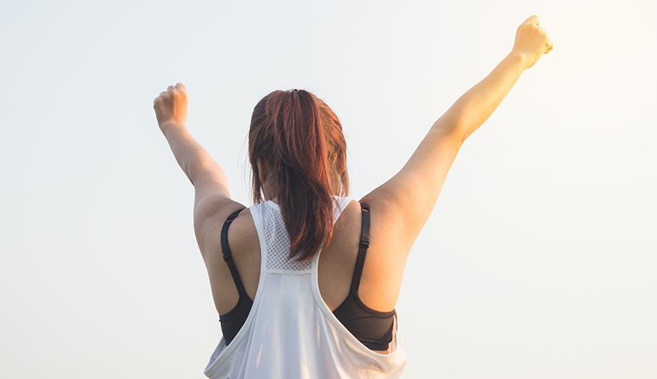 Leadership woman arms up Pexel stock column