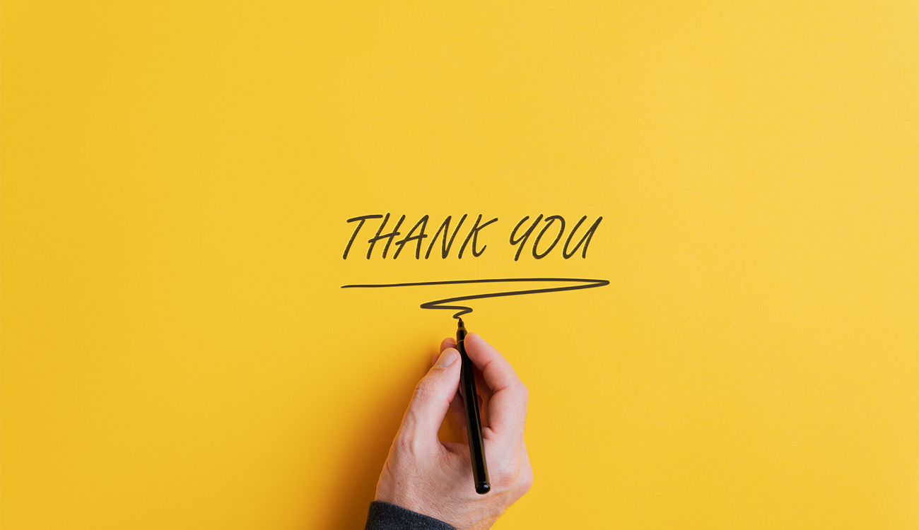 Male hand writing thank you sign column width