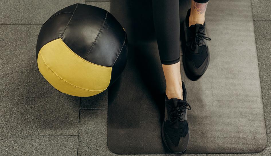 Member retention medicine ball mat woman stock column