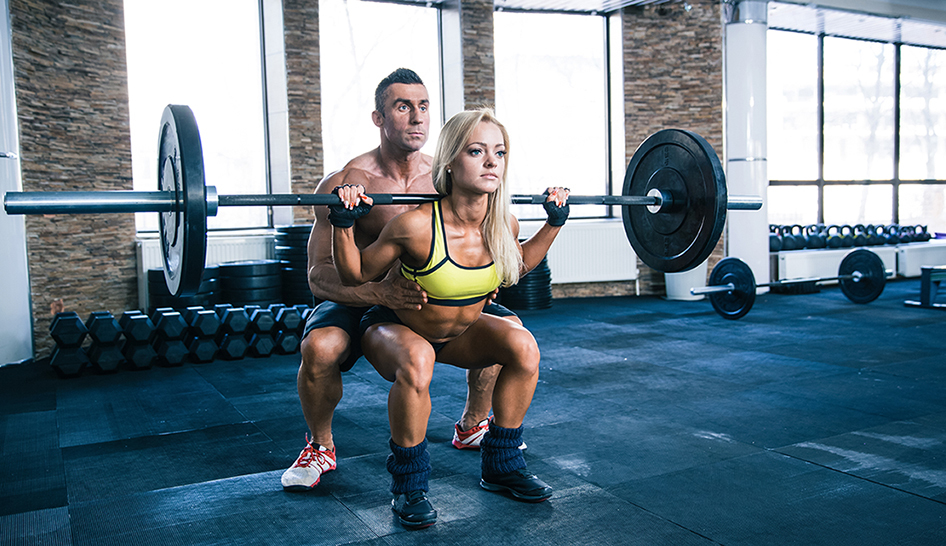 Personal Trainer Woman Workout With Barbell At Gym Column Width
