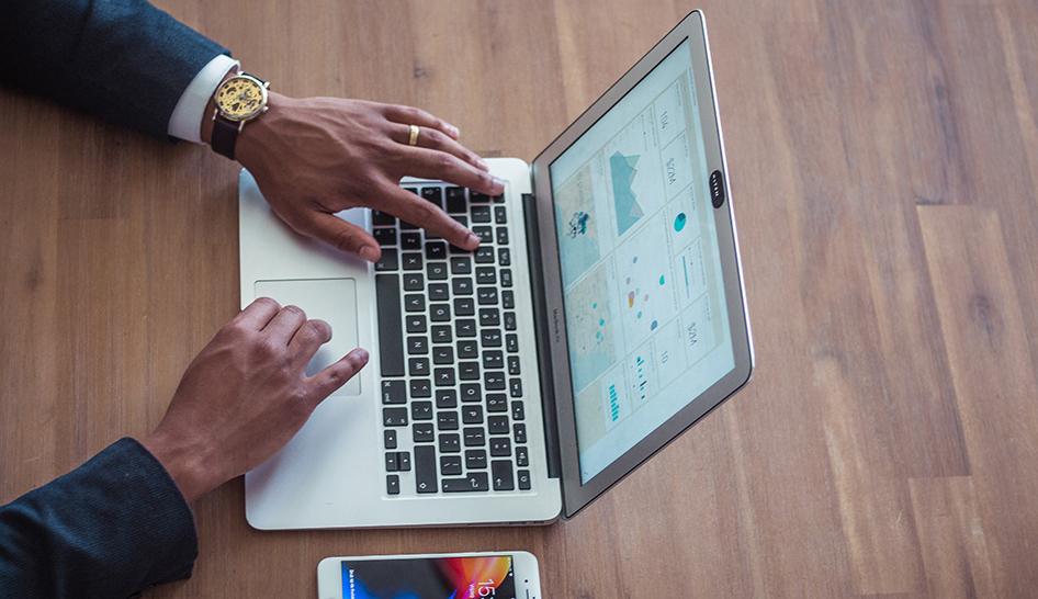 Sales and marketing businessman laptop sales analytics Unsplash stock column