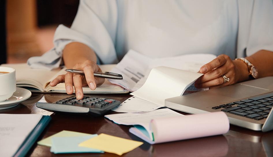 Strategy and finance woman calculating budget Freepik stock column
