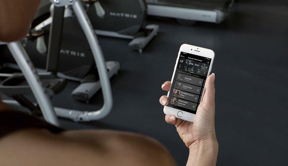 Technology MX20 woman checking workout on phone column