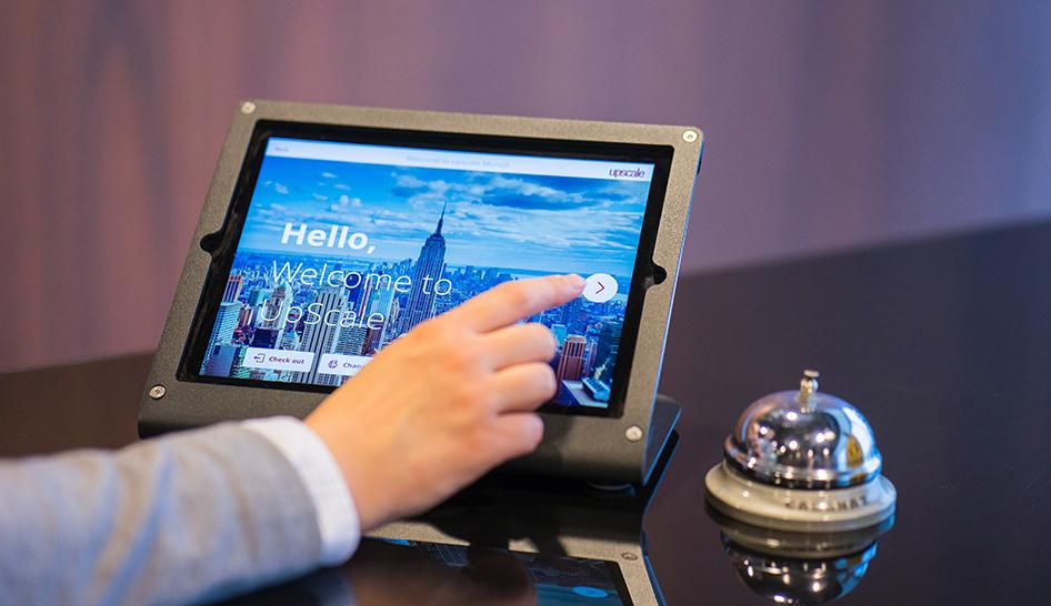 Technology front desk tablet sign in Unsplash stock column
