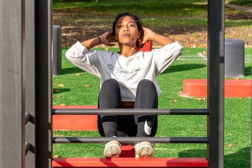Wellness woman exercising outdoors unsplash column