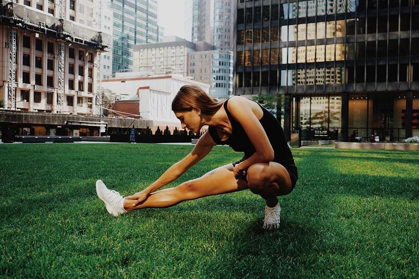 Wellness woman stretching unsplash column