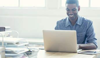Man desk laptop CBI stock photo listing