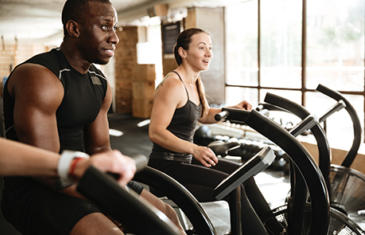 4 Reasons to Keep Going to the Gym During an Outbreak happy people equipment listing image