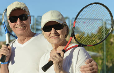 Wellness Seniors Playing Tennis