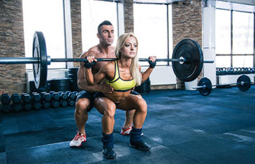 Personal Trainer Woman Workout With Barbell At Gym Listing Image
