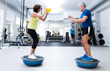 Senior Couple In Gym Working Out Listing Image